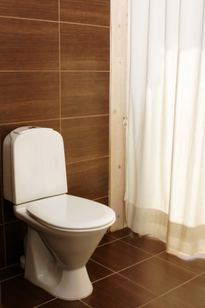 Toilet in the bathroom - a hotel room Stock Photo