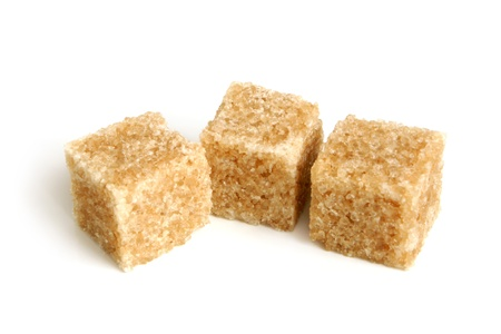 lump: Cane sugar cubes on a white background