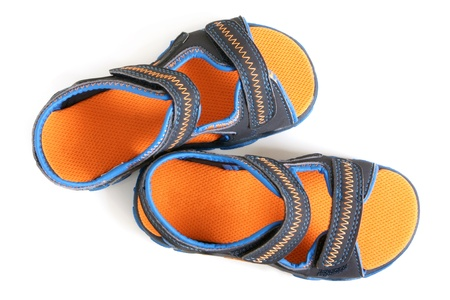 Childs sandals on a white background photo