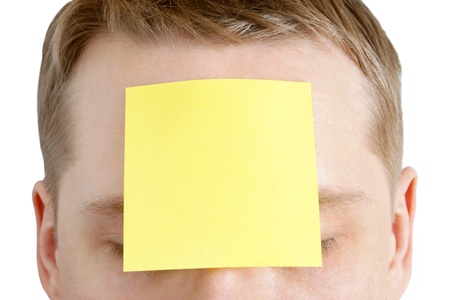 Portrait of man with a blank adhesive note on the forehead photo