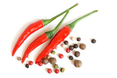 peppercorns: Red chili peppers and peppercorns on a white background