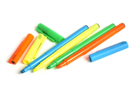 Colored markers on a white background photo