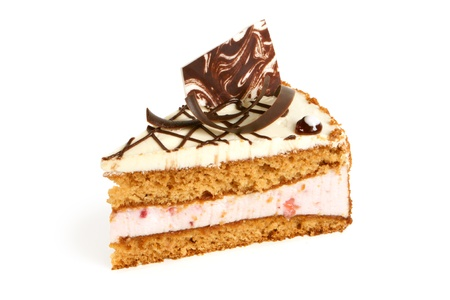 Slice of cream cake with chocolate on a white background