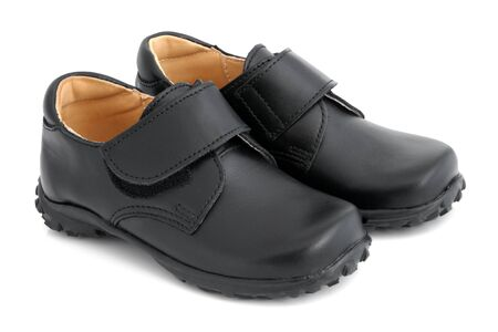Childs black shoes on a white background photo