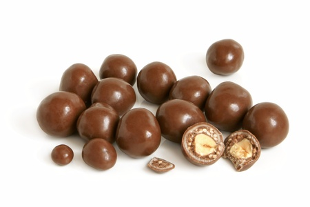 Hazelnuts in chocolate on a white background Stock Photo