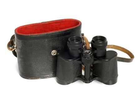 Old binoculars and leather case on a white background photo
