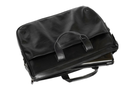 Black leather computer bag with laptop on a white background photo