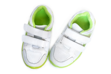 Childs sport shoes on a white background photo