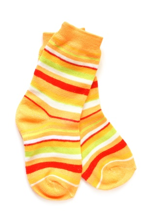 Pair of childs striped socks on a white background photo
