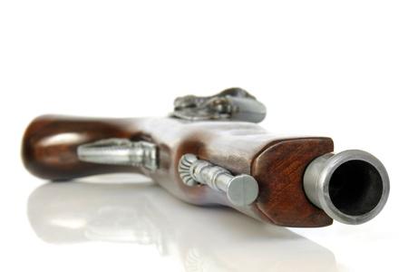 barker: Flintlock pistol on white background