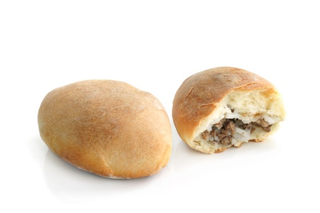 pasty: Pair of hot patties with meat and rice on a white background