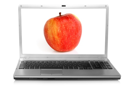 Red apple on notebook screen on a white background photo