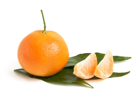 peeled off: Fresh tangerine with leaves and segments on a white background Stock Photo