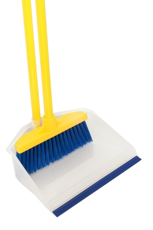 Broom and dustpan on a white background photo