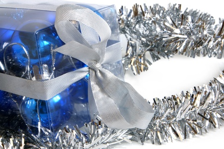 Tinsel and box with christmas balls on a white background Stock Photo - 11157010