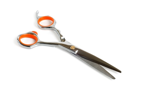 Haircutting scissors on a white background photo