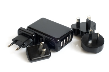 adapters: Black electrical adapters to USB port on a white background Stock Photo