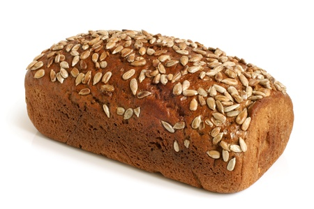 Rye bread with sunflower seeds on a white background photo