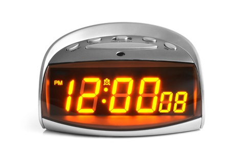 Digital electronic clock on a white background photo