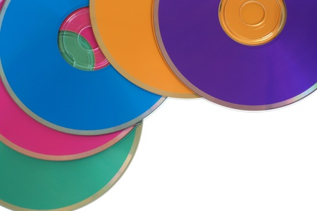 Many colorful multimedia disks on a white background photo
