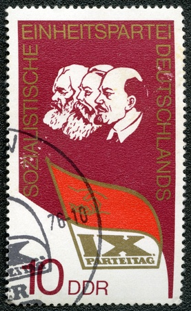 marx: GERMANY - CIRCA 1976: A stamp printed in Germany shows Lenin, Marx, Engels and dedicated at the IX congress of the socialistic party of Germany, circa 1976