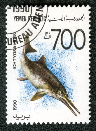 YEMEN REPUBLIC - CIRCA 1990: A stamp printed in Yemen shows Ichtyosaurus, series devoted to prehistoric animals, circa 1990.