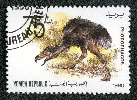 YEMEN REPUBLIC - CIRCA 1990: A stamp printed in Yemen shows Phororhacos, series devoted to prehistoric animals, circa 1990.