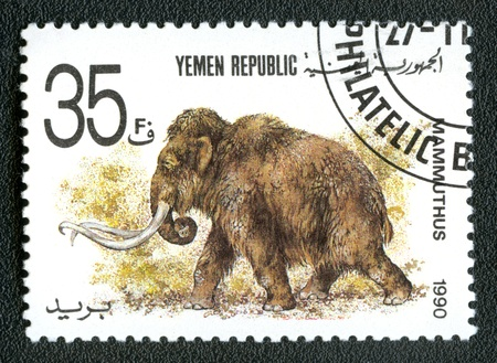 devoted: YEMEN REPUBLIC - CIRCA 1990: A stamp printed in Yemen shows Mammuthus, series devoted to prehistoric animals, circa 1990. Editorial