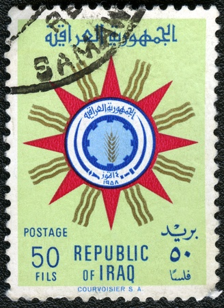 IRAQ - CIRCA 1959: A stamp printed in Iraq shows State Emblem of Republic of Iraq, circa 1959