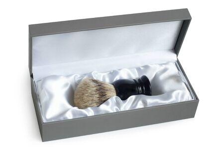 Shaving brush in box on a white background photo