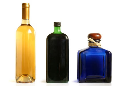 Bottles of alcoholic drinks on a white background photo