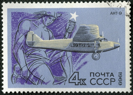 USSR - CIRCA 1969: A stamp printed by USSR shows passenger aircraft ANT-9, series, circa 1969 photo