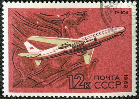 USSR - CIRCA 1969: A stamp printed by USSR shows  turbojet-powered Soviet airliner TU-104, series, circa 1969 photo