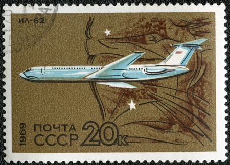 USSR - CIRCA 1969: A stamp printed by USSR shows  long-range jet airliner IL-62, series, circa 1969 photo