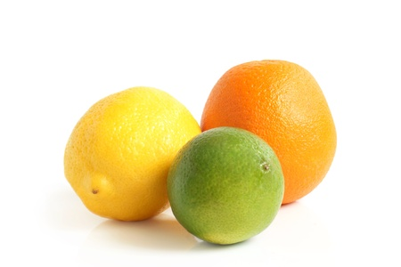 The composition of lemon, lime and orange on a white background Stock Photo - 12184066
