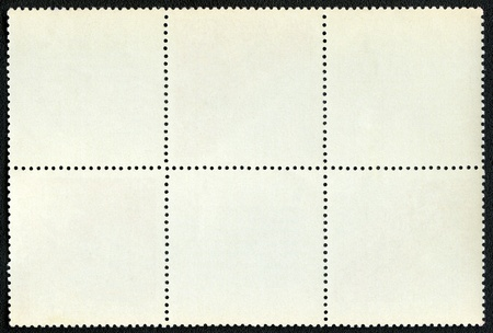 blanked: Blank postage stamps block of six framed on a black background Stock Photo