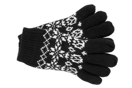 frost bound: Warm woolen knitted gloves isolated on a white background