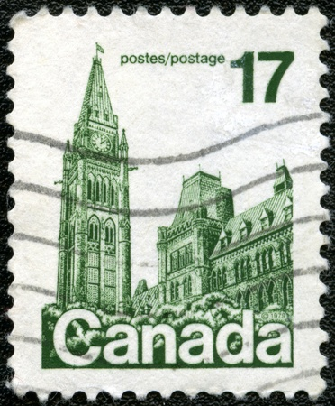CANADA - CIRCA 1979:A stamp printed in Canada shows The Centre Block is the main building of the Canadian parliamentary complex on Parliament Hill, in Ottawa, Ontario, circa 1979 photo