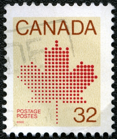 CANADA - CIRCA 1982: A stamp printed in Canada shows Maple Leaf, a symbol of Canada, circa 1982 photo