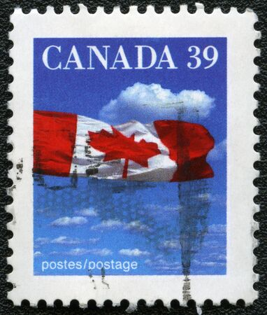 CANADA - 1990: A stamp printed in Canada shows image of the Canadian flag, series, 1990 photo