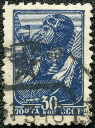 USSR - CIRCA 1939: A stamp printed in USSR shows aviator, series, circa 1939