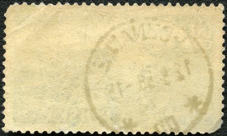 sello postal: En el reverso de un sello postal sobre un fondo negro Foto de archivo