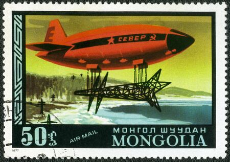 dirigible: MONGOLIA - CIRCA 1977: A stamp printed in Mongolia shows dirigible North, Russian heavy duty cargo, Dirigibles, series, circa 1977 Stock Photo