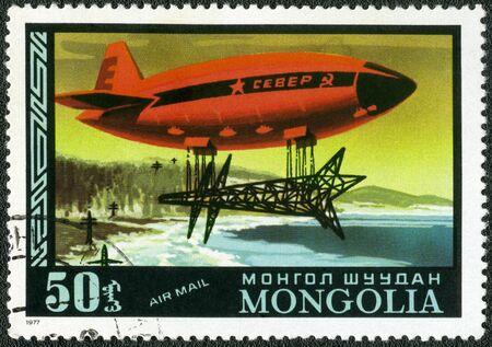 aeronautic: MONGOLIA - CIRCA 1977: A stamp printed in Mongolia shows dirigible North, Russian heavy duty cargo, Dirigibles, series, circa 1977 Stock Photo