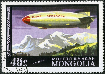 MONGOLIA - CIRCA 1977: A stamp printed in Mongolia shows semi-rigid airship SSSR-V6 Osoaviahim, Russian Arctic cargo, Dirigibles, series, circa 1977