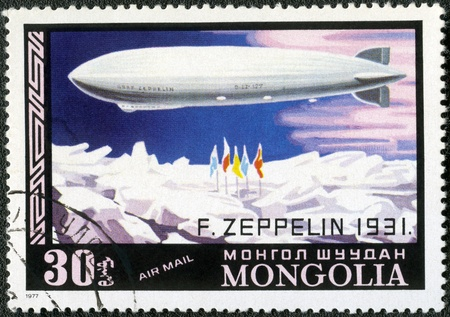 aeronautic: MONGOLIA - CIRCA 1977: A stamp printed in Mongolia shows dirigible balloon F.Zeppelin over North Pole, Dirigibles, series, circa 1977