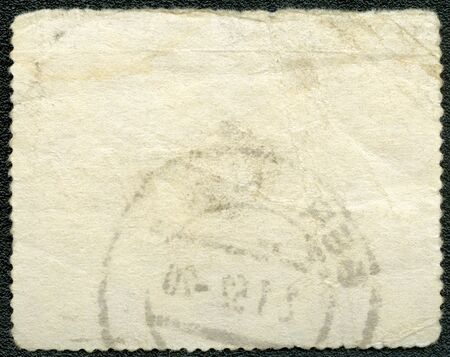 The reverse side of a postage stamp on a black background Stock Photo - 12505368