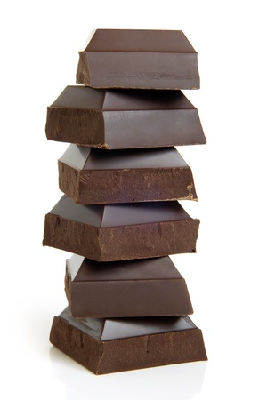 dark chocolate: Stack of chocolate pieces on a white background