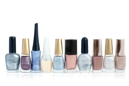 colored bottle: Nail polish bottles in a row on a white background