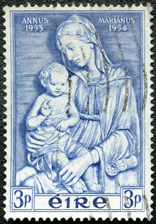 IRELAND - CIRCA 1954  A stamp printed in the Ireland, shows Madonna by della Robbia, Marian Year, 1953-54, circa 1954 Stock Photo - 12505381